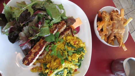 Tofu scramble with tempeh bacon, and a side of vegan, gluten-free poutine, at Brooklyn Street.