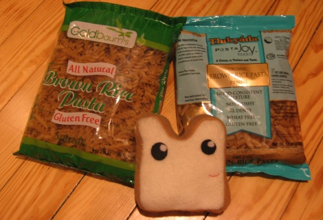 Happy bread is happy, and is surrounded by brown rice pasta.