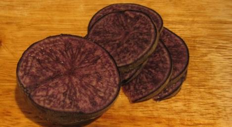 Sliced purple potaoes.