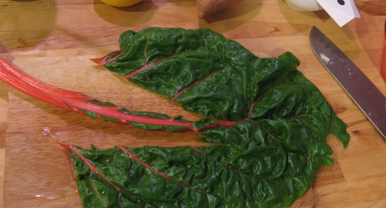 Removing the stems from chard.
