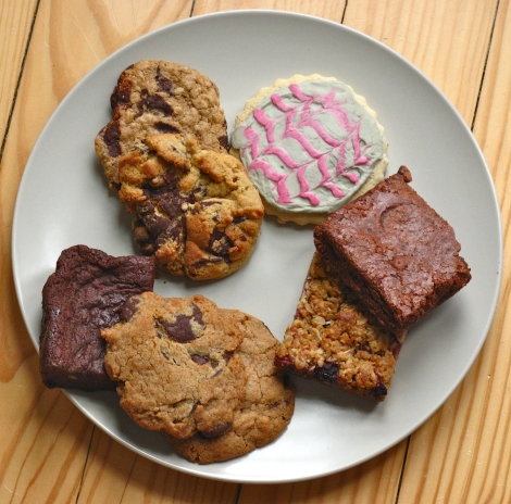 An lovely plate of gluten-free cookies, brownies, berry bars and sugar cookies.