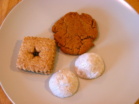 From bottom, to the right: vegan snowballs; gluten-free peanut butter cookies; berry bars.
