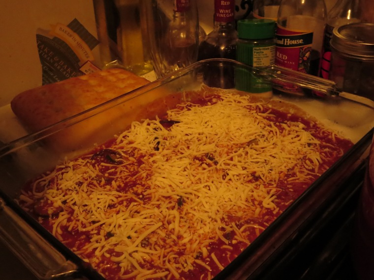 Add a layer of noodles, sauce and cheese...