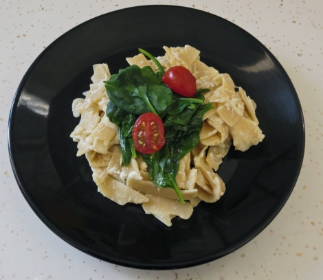 Mrs. Glee's gluten-free bean noodles with spinach, feta and tomatoes.