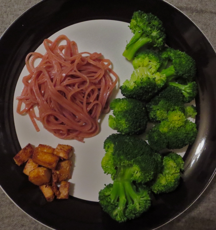 Red rice noodles with broccoli and tofu.