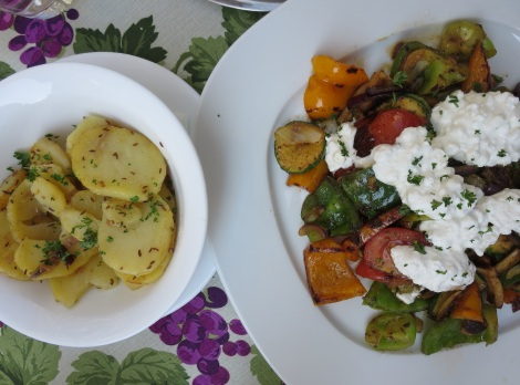 Roasted veggies with cheese, and potatoes.