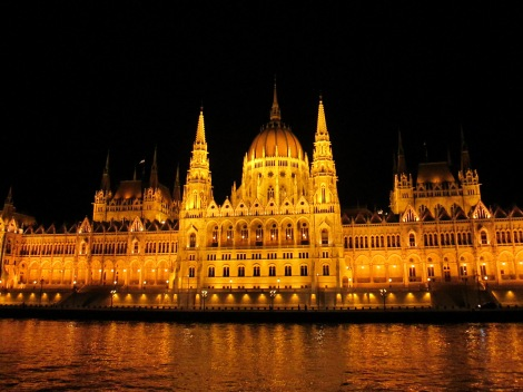 The Parliament Building at night, as seen from the Danube.
