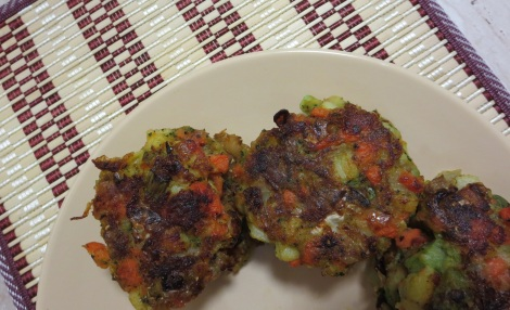 A trio of cooked bubble and squeak patties.