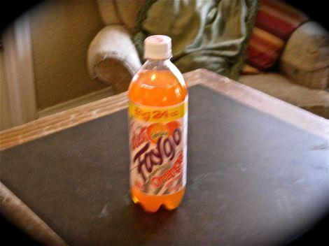 A bottle of orange Faygo.