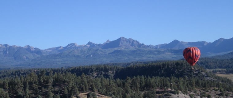 Hot air balloon over the mountains in Pagosa Springs.