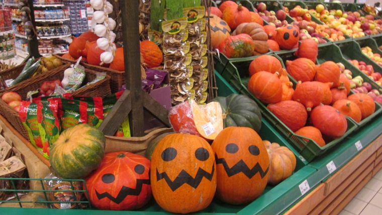 Painted pumpkins at the grocery store.