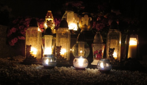 Candles on a grave ledger, Wrocław.