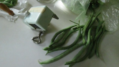 Uncooked beans and a French-press slicer from Germany.
