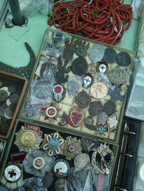 Some historical pins from a local flea market. Look carefully...