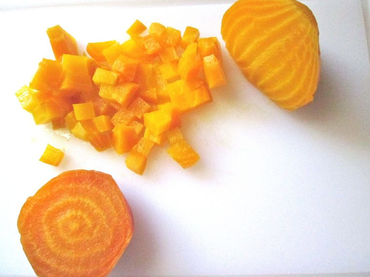 Slices and cubes of golden beets.